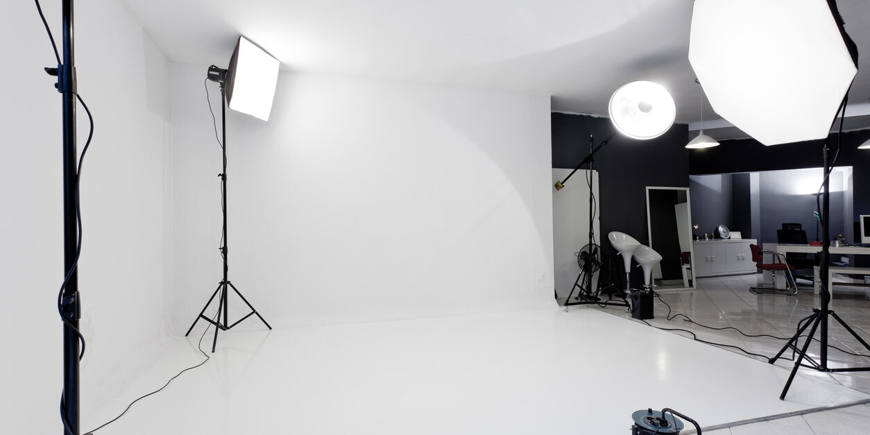 Photo studio with flash lights, stands and backgrounds.